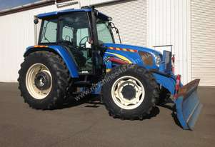 New Holland T5040 Tractor with front blade / stick rake