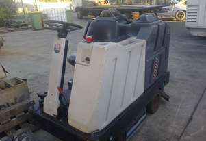 Nilfisk Advance 3800 ride on electric scrubber with sweeper attachment