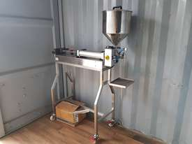 Rotary Piston Bottle Filler - picture0' - Click to enlarge