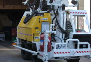 Shotcrete - The worlds most compact self contained robotic shotcrete rig.