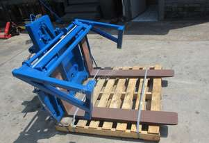 Rotating Fork /Bin Hold Down, Forklift Attachment
