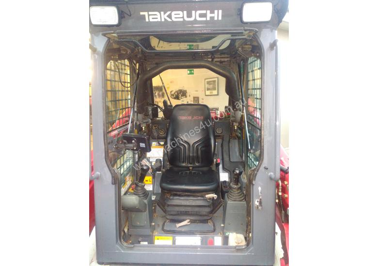 Takeuchi TL10 track loader with rippers and fork tines