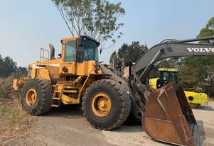 Volvo L150C frontend loader with ROPS cabin, weight scales, good rubber, large bucket rebuild.