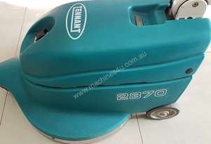 Tennant   vacuum floor polisher