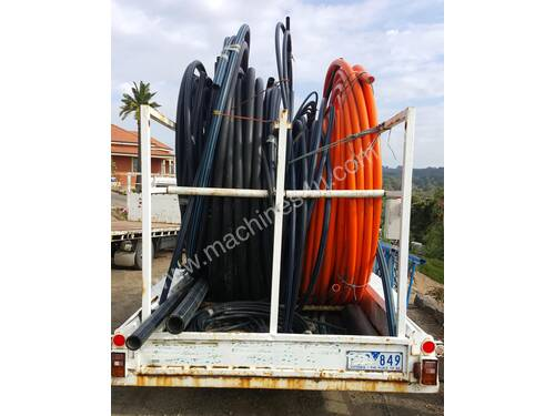 AGRICULTURAL PIPE CARRYING TRAILER WITH PIPES