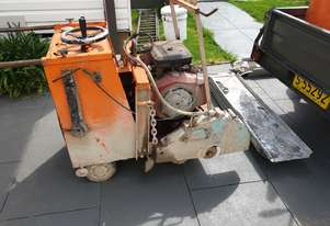 Walk behind concrete saw on trailer plus more