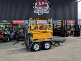 *RENTAL* 8 METER ELECTRIC SCISSOR LIFT(ON TRAILER) - picture0' - Click to enlarge