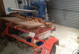 Vintage Sawmaster, with long radial arm, wth rollers, stands and trailering