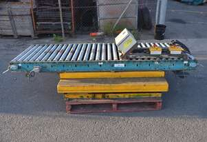Motorised powered 2.4m long 73cm wide roller conveyor system with scissor lift