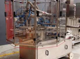 Rotary Tub Filling / Sealing Machine - picture1' - Click to enlarge