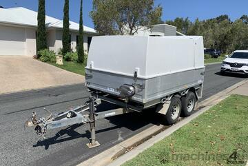 Pressure cleaning trailer with hot water and vacuum recovery