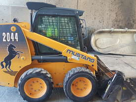 Used A/C Cab, T-Bar Steering, 4 in 1 Bucket Mustang 2044 Skid Steer - picture1' - Click to enlarge