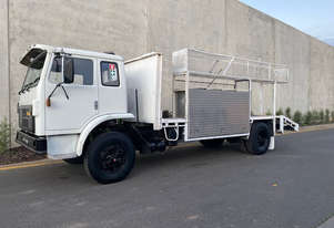 International Acco 1850D Beavertail Truck
