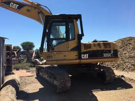 Cat 325C excavator with Randalls log grapple - picture1' - Click to enlarge