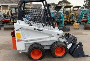 Tcm BOBCAT 315 with 4 in 1 bucket