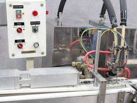 Chap Stick Puc Filling Line - picture1' - Click to enlarge