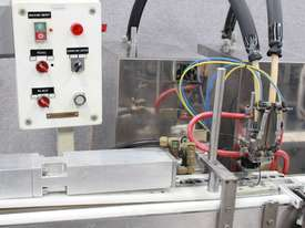 Chap Stick Puc Filling Line - picture2' - Click to enlarge
