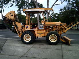 8020  trencher plow / combo , ex telstra fleet , 1668 hrs , new chain sprockets and teeth - picture0' - Click to enlarge