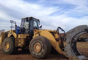 Cat 980G wheel loader with log forks/bucket