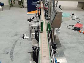 Bottling filling/capping/labelling line - picture1' - Click to enlarge