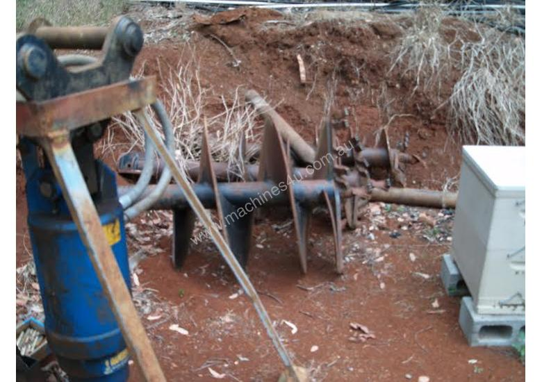 Auger with built in relieve valve