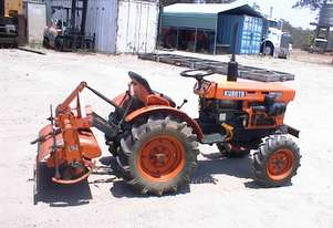 Kubota B7100 tractor and implements