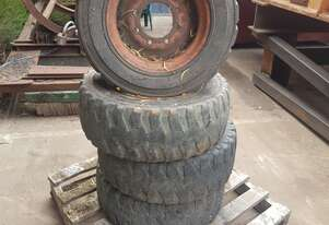 4 x Tyre and rims to suit New Holland LS140 Skid Steer