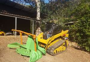 110hp SkidSteer Posi Track w/ Mulcher Attachment