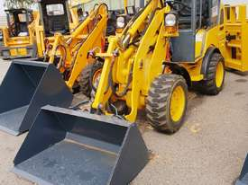 UNUSED HT35J Articulated Mini Wheel Loader with Perkins Engine complete with GP Bucket & Pallet Fork - picture0' - Click to enlarge