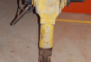 Electric jackhammer with three sharp points.