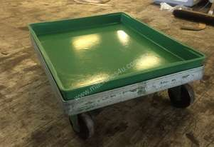parts storage in trays and on trolleys