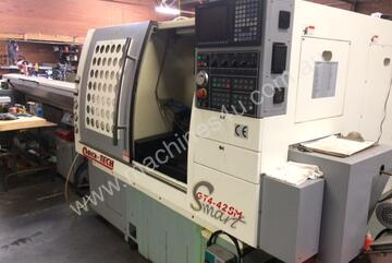 Quick Tech GT4 CNC production lathe with barfeed