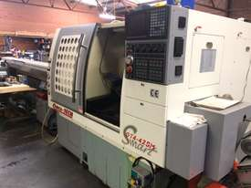Quick Tech CNC production lathe with barfeed - picture0' - Click to enlarge
