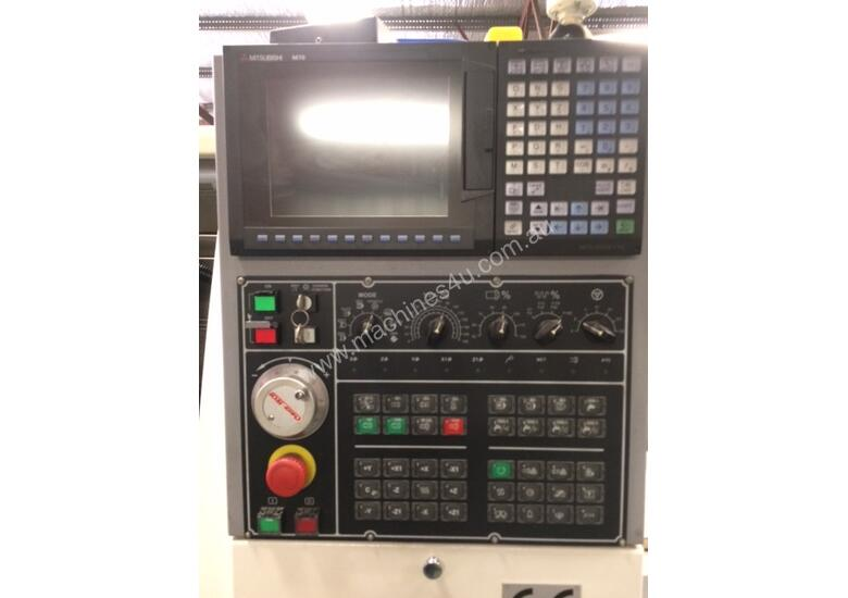 Quick Tech CNC production lathe with barfeed