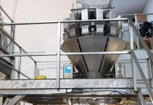 Ulma VFFS Packaging Machine with 14 head weigher, bucket elevator and platform.