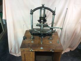 Antique engraving machine