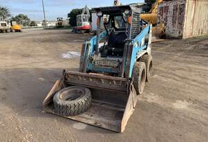 Skid Steer Loader 4 in 1 bucket JUST REDUCED PRICE TO SELL
