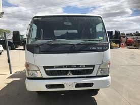 2009 Mitsubishi Fuso Canter Duel Cab Tipper - picture1' - Click to enlarge