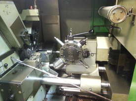 Mupem 6 Axis Automatic lathe with Polygon attachment and barfeeder - picture1' - Click to enlarge