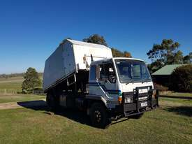 ***MAKE AN OFFER *** 1994 MITSUBISHI FM557JS TIPPER/CHIPPER - picture0' - Click to enlarge
