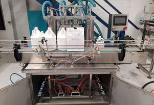 4 head liquid filling  machine (auto linear with internal pump) 1ltr/4ltr capacity. Gravity feed.