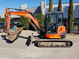 USED KUBOTA U55-4 EXCAVATOR WITH FULL A/C CABIN, QUICK HITCH, 4 BUCKETS, RUBBER TRACKS AND 4036 HOUR - picture0' - Click to enlarge