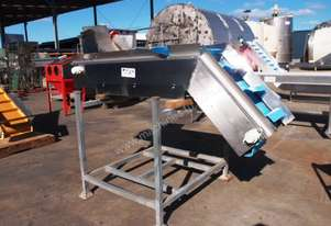 Incline Cleated Belt Conveyor.