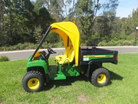John Deere TX Gator with roll cage
