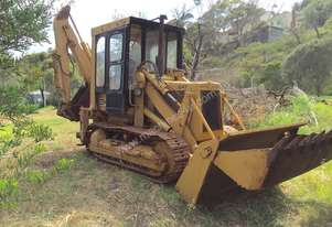 Caterpillar Loader back hoe with tracks