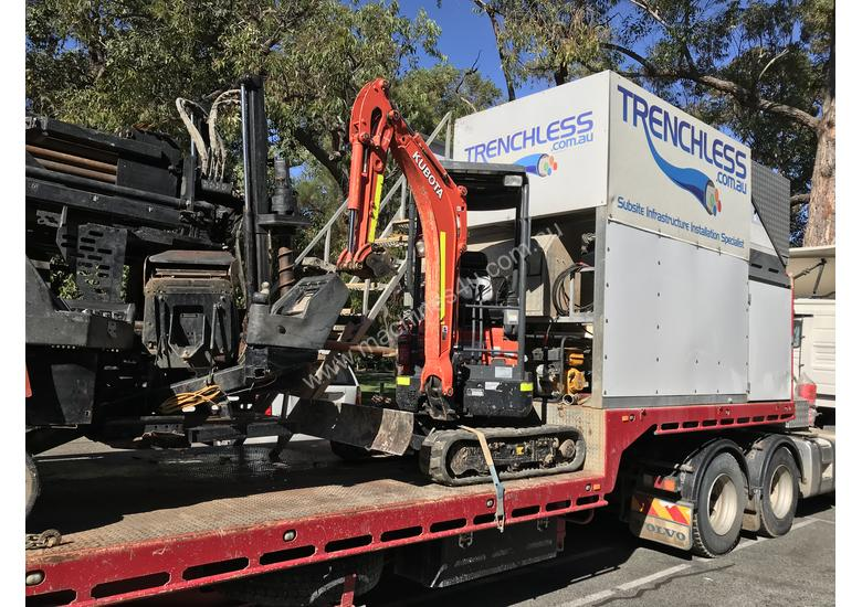 Ditch Witch JT3020 All Terrain Horizontal Directional Drill and Volvo Semitrailer