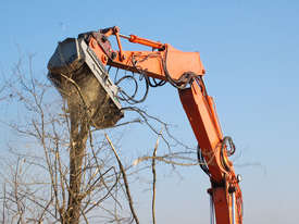 Mulcher with fixed teeth rotor for excavators having a weight between 18 and 25 t. - picture0' - Click to enlarge