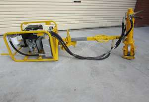 RAILWAY TRACK-PACK WITH SPIKE PULLER