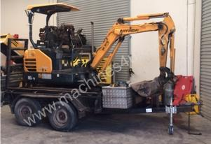 2014 Hyundai Robex with plant trailer & attacments